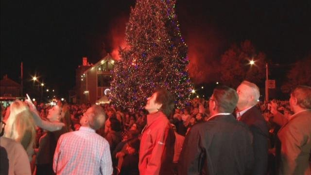 FILE: Crowds watch as the fireworks are lit off at the 2016 Christmas on Broadway lighting.