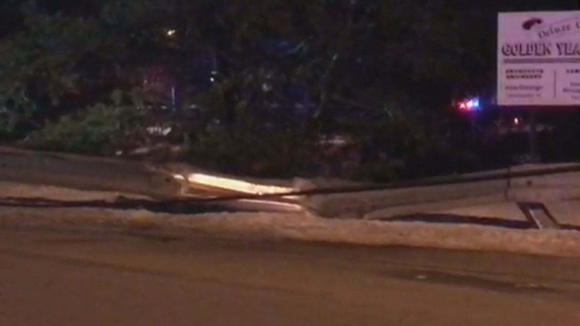 Scene of the crash where a pole was knocked down along with wires.