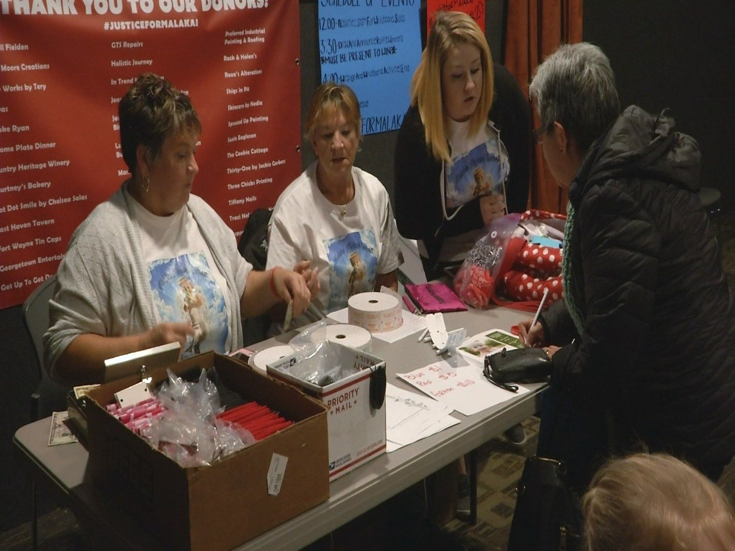 Event organizers sell raffle tickets with proceeds going to the Garrett family
