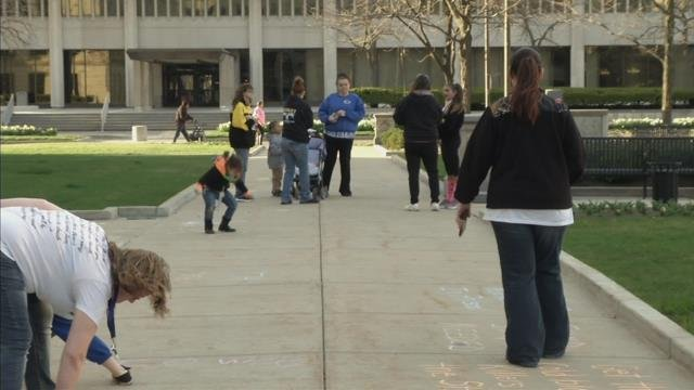 """Families cover the courthouse sidewalks with """"Justice for JoJo"""" messages"""