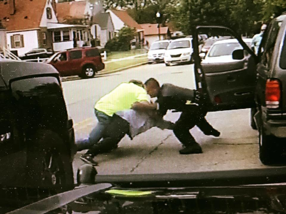 Taken from the dash-cam from the officer's vehicle, this shows Mr. Baum assisting HPD in securing a dangerous suspect. (Photo//Hammond Indiana Police Department)